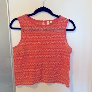 Coral crop top with textured fabric.
